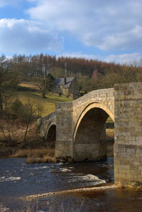 Stone bridge over River Wharfe in Yorkshire dales
