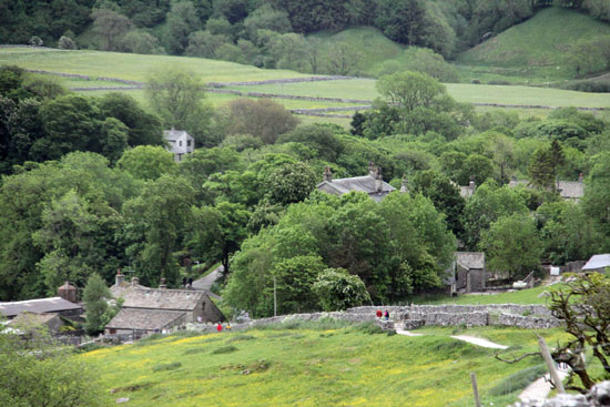 Tourists walking from Malham village
