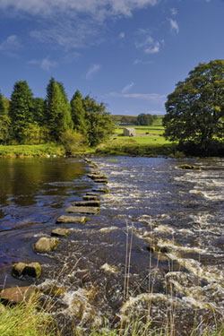 Yorkshire dales River with stepping stones for a fun holiday